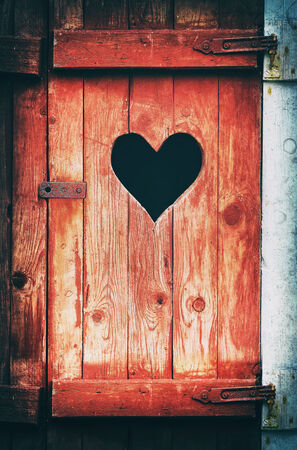 toilet door: Old vintage toilet door with a heart shaped hole, filters applied