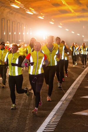 group link: STOCKHOLM - 22 NOV: Group of runners in the Stockholm Tunnel Run. Stockholm, 22 November 2014. A 10 km long race in Northern Link tunnelsystem before it opens for traffic.