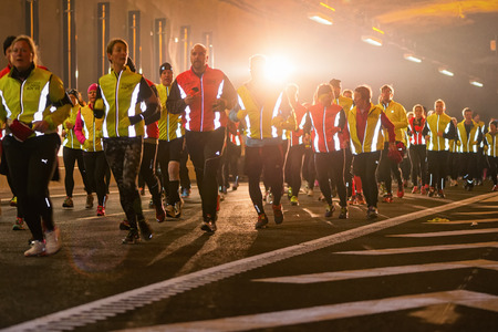 STOCKHOLM - 22 NOV: Big group of runners in the Stockholm Tunnel Run. Stockholm, 22 November 2014. A 10 km long race in Northern Link tunnelsystem before it opens for traffic.