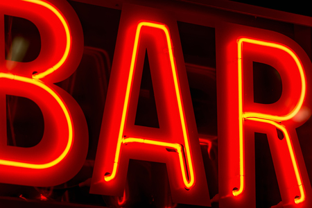 Bar sign in neon lights, yellow and red photo