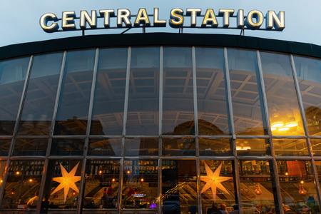 '5 december': STOCKHOLM - DEC 5: Stockholm Central station with warm lights from inside cafe. Stockholm 5 December 2014. Editorial