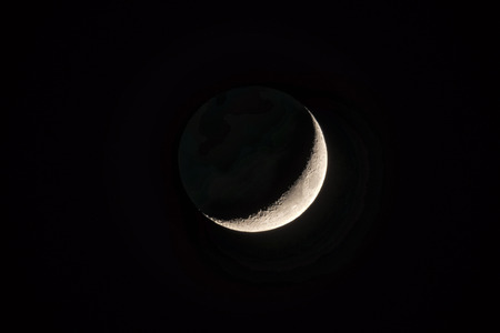 Half moon or Waxing Crecent in the supermoon state on black night sky, approx 10 procent bigger than usual Stock Photo