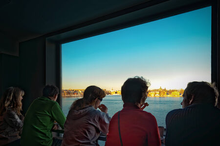 pass away: STOCKHOLM, DEC 27: People taking a coffee break at the Fotografiska Museum and enjoying a great view over Stockholm cityscape. December 2014 in Stockholm, Sweden. Before they pass away. Editorial