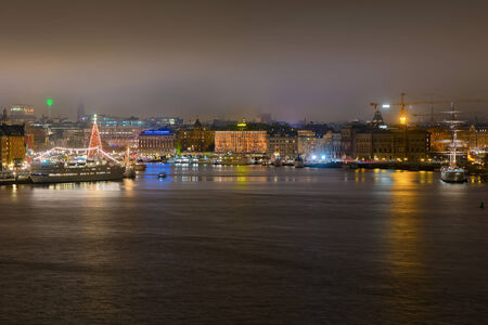 STOCKHOLM, DEC 31: View over central Stockholm during New Years evening, Stockholm, Sweden in December 31, 2014. Foggy night. Editorial