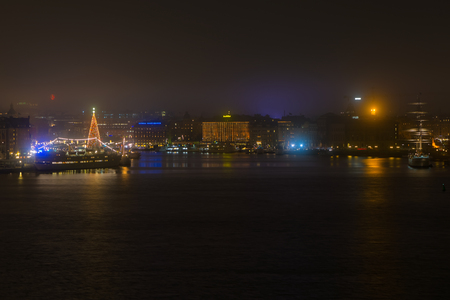 chapman: STOCKHOLM, DEC 31: View over Stockholm during New Years evening with Grand Hotel and af Chapman, Stockholm, Sweden in December 31, 2014. Foggy night. Editorial