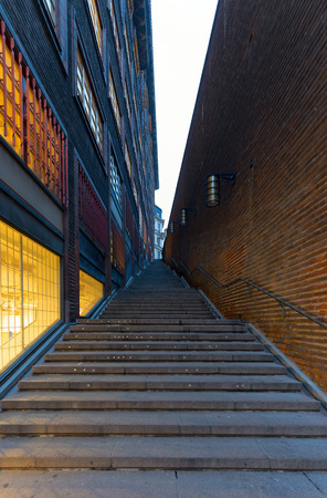 Steps leading up a dark modern alleyway, modern architecture