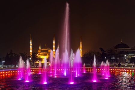 hagiasophia: ISTANBUL, TURKEY - NOV 19: Istanbul by night with colorful fountain with the blue mosque in the background, Istanbul, November 19, 2013 in Istanbul, Turkey. Editorial