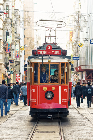 beyoglu: ISTANBUL - NOV, 21: A red classic tram in the crowded Istiklal Avenue in the Beyoglu district of Istanbul, Nov 21, in Istanbul, Turkey 2013