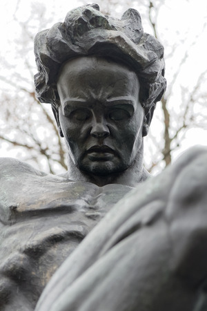 national poet: STOCKHOLM, SWEDEN - MAR 31: Closeup of statue of August Strindberg at Tegnerlunden, March 31, 2015 in Stockholm, Sweden. Massive statue of August Strindberg by Carl Eldh, from 1942.