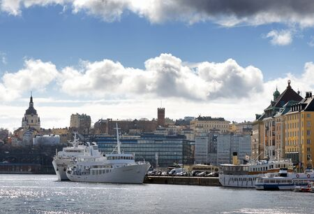 katarina: STOCKHOLM, SWEDEN - MAR 31: Slussen and the old town from the seaside with boats and clouds, March 31, 2015 in Stockholm, Sweden.