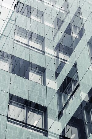 Reflections of a new office building in business center in abstract style, duplex filter photo