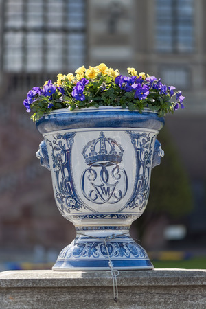 STOCKHOLM - MAY, 9, 2015: Flower pot outside the Royal castle in Stockholm with the insignia of the King Carl Gustaf XVI. May 9, 2015, Stockholm, Sweden.
