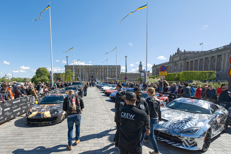 gumball: STOCKHOLM, SWEDEN - MAY 23: Gumball 3000 cars at display on the streets of Stockholm on May 23, 2015. People at the streets admiring the exotic cars at display before the start of the 2015 event. Editorial