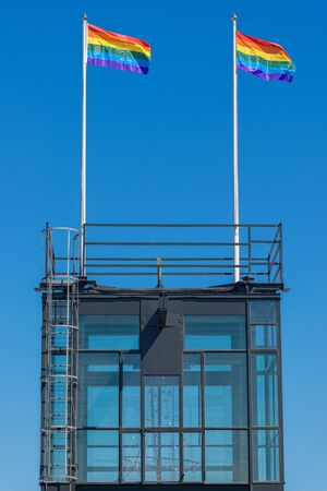 katarina: STOCKHOLM, SWEDEN - AUGUST 1, 2015: The top of the Katarina elevator (Katarinahissen) in Stockholm city with rainbow flags waving in blue sky.