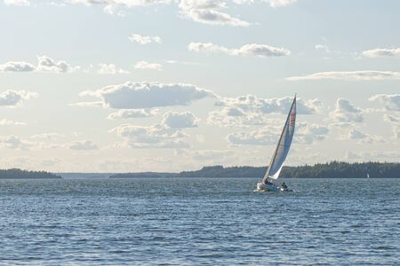 sailingboat: GRISSLEHAMN, SWEDEN - JULY 24, 2015: Sailboat sailing in the windy sunny weather.