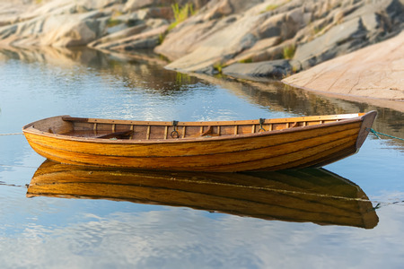 Classic rowingboat moored in warm evening light. Sweden