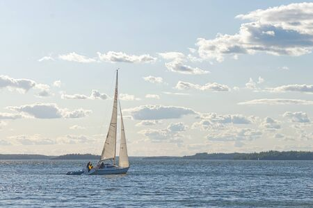 sailingboat: GRISSLEHAMN, SWEDEN - JULY 24, 2015: Sailboat sailing in windy sunny weather. Editorial