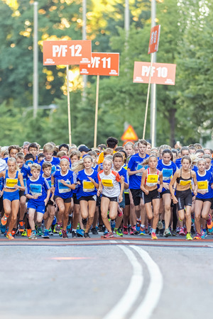 13 15 years: STOCKHOLM, SWEDEN - AUGUST 15, 2015: The starting field just after the start at Lilla Midnattsloppet for runners aged 13. The track is 1775 meters and the runners are aged 8-15 years.