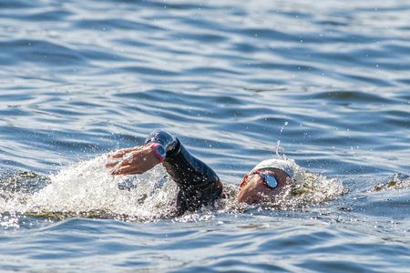 gasping: STOCKHOLM - AUG 22, 2015: Face of a female triathlete swimming and gasping for air at Womens ITU World Triathlon series event. Editorial