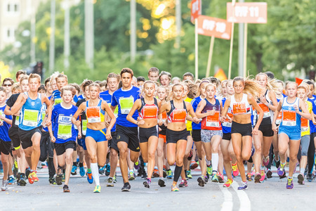 14 15 years: STOCKHOLM, SWEDEN - AUGUST 15, 2015: The starting field just after the start at Lilla Midnattsloppet for aged 14. The track is 1775 meters and the runners are aged 8-15 years.