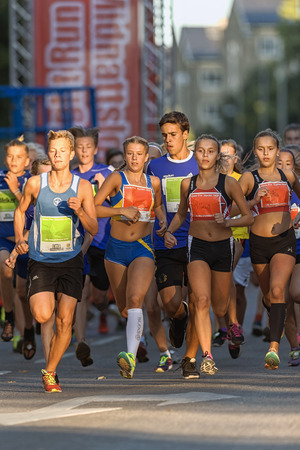 14 15 years: STOCKHOLM, SWEDEN - AUGUST 15, 2015: Front group just after the start at Lilla Midnattsloppet for aged 14. The track is 1775 meters and the runners are aged 8-15 years. Editorial