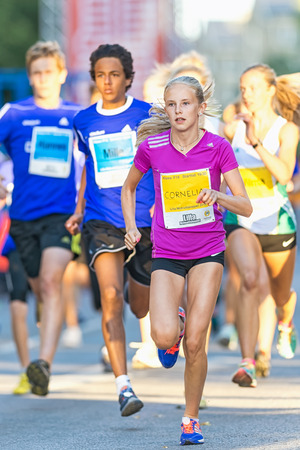 lilla: STOCKHOLM, SWEDEN - AUGUST 15, 2015: Girl leading after the start at Lilla Midnattsloppet for aged 15. The track is 1775 meters and the runners are aged 8-15 years. Editorial