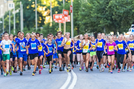 lilla: STOCKHOLM, SWEDEN - AUGUST 15, 2015: Runners just after the start at Lilla Midnattsloppet for aged 15. The track is 1775 meters and the runners are aged 8-15 years. Editorial