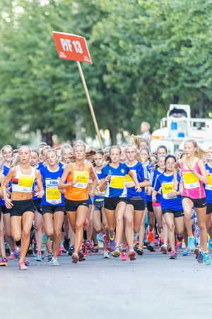 13 15 years: STOCKHOLM, SWEDEN - AUGUST 15, 2015: Runners just after the start at Lilla Midnattsloppet for runners aged 13. The track is 1775 meters and the runners are aged 8-15 years.