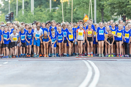 13 15 years: STOCKHOLM, SWEDEN - AUGUST 15, 2015: The starting field with nervous runners just before the start at Lilla Midnattsloppet for runners aged 13. The track is 1775 meters and the runners are aged 8-15 years.