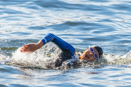 STOCKHOLM - AUG 22, 2015: Face of a female triathlete swimming at Womens ITU World Triathlon series event.