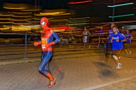 spiderman: STOCKHOLM, SWEDEN - AUGUST 15, 2015: Man in the mascerade section in spiderman costume on the streets of Soder at Midnattsloppet or the Midnight run. Editorial
