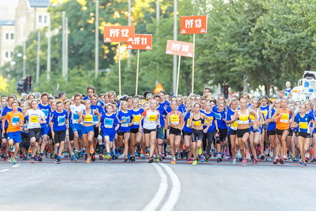lilla: STOCKHOLM, SWEDEN - AUGUST 15, 2015: The starting field just after the start at Lilla Midnattsloppet for runners aged 13. The track is 1775 meters and the runners are aged 8-15 years.