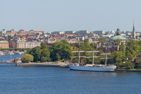 chapman: STOCKHOLM, SWEDEN - AUGUST 10, 2015: Overview of Stockholm with the boat Af Chapman in the foreground.