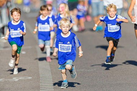 sports race: STOCKHOLM, SWEDEN - AUGUST 15, 2015: Group of small kids at the Minimil for the youngest runners at Midnattsloppet. The track is 300 meters and the runners are aged 2-8 years. Editorial