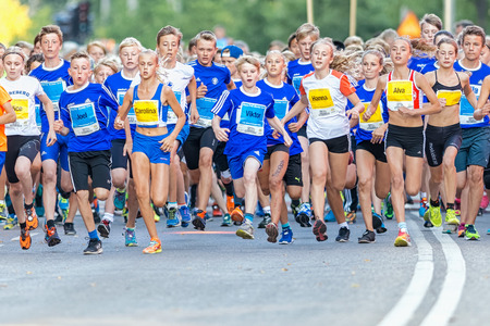 lilla: STOCKHOLM, SWEDEN - AUGUST 15, 2015: Runners just after the start at Lilla Midnattsloppet for runners aged 13. The track is 1775 meters and the runners are aged 8-15 years.