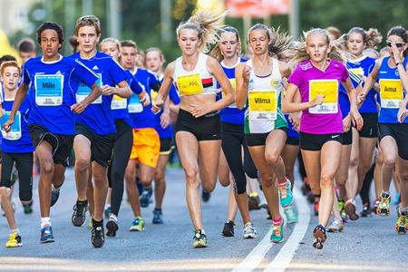 lilla: STOCKHOLM, SWEDEN - AUGUST 15, 2015: Group just after the start at Lilla Midnattsloppet for aged 15. The track is 1775 meters and the runners are aged 8-15 years.
