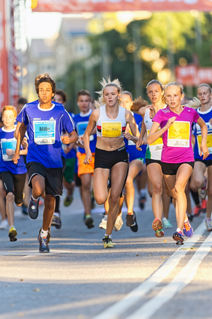 lilla: STOCKHOLM, SWEDEN - AUGUST 15, 2015: Leading group after the start at Lilla Midnattsloppet for aged 15. The track is 1775 meters and the runners are aged 8-15 years.