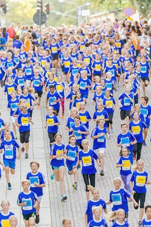lilla: STOCKHOLM, SWEDEN - AUGUST 15, 2015: Big group of runners at Lilla Midnattsloppet for aged 9. The track is 1775 meters and the runners are aged 8-15 years. Editorial