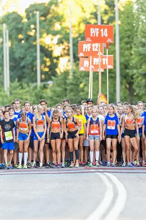 lilla: STOCKHOLM, SWEDEN - AUGUST 15, 2015: Nervous group of runners waiting for the start at Lilla Midnattsloppet for aged 14. The track is 1775 meters and the runners are aged 8-15 years. Editorial