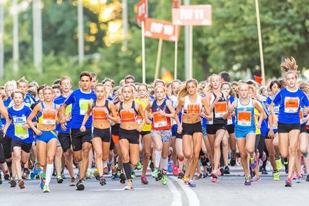 lilla: STOCKHOLM, SWEDEN - AUGUST 15, 2015: The starting field just after the start at Lilla Midnattsloppet for aged 14. The track is 1775 meters and the runners are aged 8-15 years.