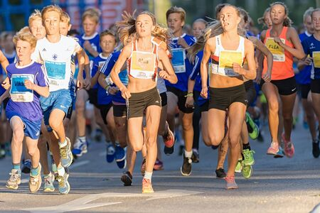 13 15 years: STOCKHOLM, SWEDEN - AUGUST 15, 2015: Start of the midnight run fot teens or Lilla Midnattsloppet for runners aged 13. The track is 1775 meters and the runners are aged 8-15 years.