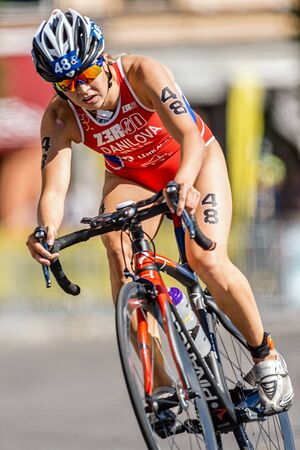rus: STOCKHOLM - AUG 22, 2015: Elena Danilova (RUS) down the cobblestones at the Womens ITU World Triathlon series event in Stockholm. Editorial