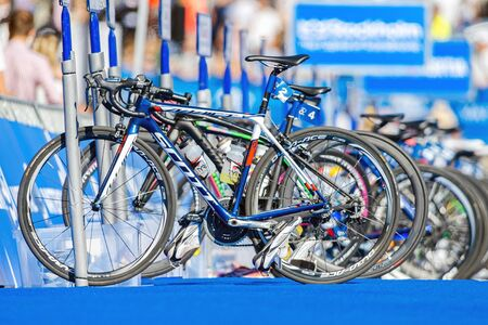STOCKHOLM - AUG 22, 2015: Bikes on a row (Sarah Trues bike first with nr 2) with equipment after the transition at the Womens ITU World Triathlon series event in Stockholm. Editorial