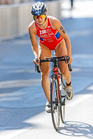 rus: STOCKHOLM - AUG 22, 2015: Triathlete Elena Daniela (RUS) cycling closeup at the old town in the Womens ITU World Triathlon series event in Stockholm.