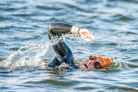 gasping: STOCKHOLM - AUG 23, 2015: Triathlete swimming and gasping for air at the Womens ITU World Triathlon event in Stockholm.