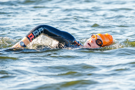 gasping: STOCKHOLM - AUG 23, 2015: Swimming triathlete at the Womens ITU World Triathlon event in Stockholm.