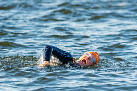 gasping: STOCKHOLM - AUG 23, 2015: Triathlete gasping for air at the Womens ITU World Triathlon event in Stockholm.