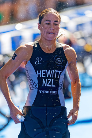 changing clothes: STOCKHOLM - AUG 22, 2015: Andrea Hewitt (NZL) changing clothes for cycling at the Womens ITU World Triathlon series event in Stockholm.
