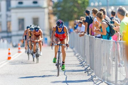 esp: STOCKHOLM - AUG 22, 2015: Carolina Routier (ESP) leading before a group of cyclists at the Womens ITU World Triathlon series event in Stockholm.