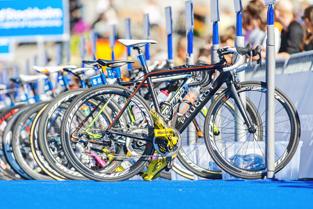 STOCKHOLM - AUG 22, 2015: Bikes on a row with equipment after the transition at the Womens ITU World Triathlon series event in Stockholm.